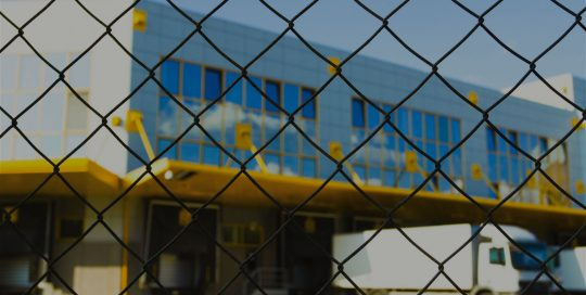 Commercial Building Behind Chainlink Fence